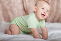 Infant baby playing at home on the bed Royalty Free Stock Images