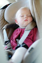Infant baby sleeping in a car seat Stock Photo