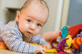 Infant boy with toys Royalty Free Stock Images