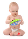 Infant child baby boy toddler playing with whirligig toy Royalty Free Stock Photo