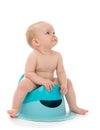 Infant child baby boy toddler sitting on potty toilet stool pot Royalty Free Stock Photo