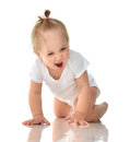 Infant child baby girl in diaper crawling happy laughing smiling Royalty Free Stock Photo