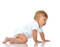 Infant child baby girl in diaper crawling happy looking at the c Royalty Free Stock Photo