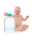 Infant child baby girl sitting with big bottle of drinking water Stock Photos