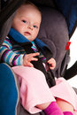 Infant child sitting in car seat Royalty Free Stock Photos