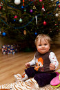 Infant and Christmas Tree Stock Photography