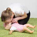 Infant CPR breathing Royalty Free Stock Photo