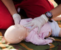 Infant dummy cpr training first aid training Royalty Free Stock Photos
