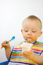 Infant Eating Yoghurt Messily Stock Photos