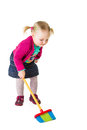 Infant girl child with a broom isolated on white Royalty Free Stock Photos