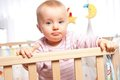 Infant in playpen Royalty Free Stock Images