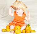 Infant with pumpkins Royalty Free Stock Photos