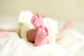 Infant small feet lovely closeup Royalty Free Stock Photos