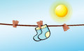 An infant socks hanging with clips illustration of Stock Photo