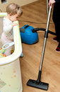 Infant and Vacuum Cleaner Royalty Free Stock Photo