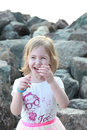 Infectious laughter blonde little girl walks on the beach Stock Images