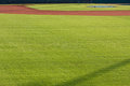 Infield Dirt And Outfield Grass Of Baseball Field