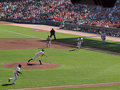 Infielders run in to grab bunt as Matt Cain throws Stock Images