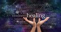 Infinite healing words healer s open palms reaching up with a deep space background of planets stars and cloud formations Royalty Free Stock Images