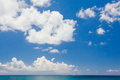 Infinite sky above the sea blue with white clouds caribbean Royalty Free Stock Photos
