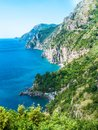 Wild coastline cliff covered with trees at Positano, Amalfi Coast, Naples, Italy Royalty Free Stock Photo