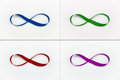 Infinity loops green red blue and violet Royalty Free Stock Images