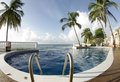 Infinity pool with float caribbean sea Royalty Free Stock Photos