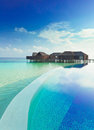 Infinity pool and water villas Royalty Free Stock Photo