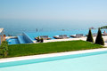 Infinity swimming pool by beach at the modern luxury hotel pieria greece Stock Photo