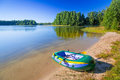 Inflatable dinghy at the summer lake in poland Royalty Free Stock Images