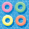 Inflatable rings floating on water, vector Royalty Free Stock Photo