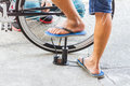 Inflate the bicycle tyre with compact air compressor by action man Stock Photo