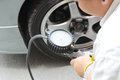 Inflate tires and check pressure of Royalty Free Stock Photos