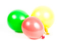 Inflated and deflated balloon over white background Royalty Free Stock Image