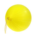 Inflated yellow punch ball on white a side view of a new with an attached springy stretchy handle a background Stock Image