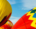Inflating hot air balloons three colorfull are being inflated for flight Royalty Free Stock Images
