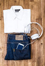 Informal outfit with cellphone male and headphone background Stock Photo