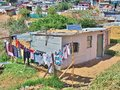 Informal settlement in South Africa with solar panels. Royalty Free Stock Photo