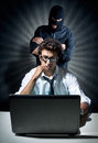Informatics spy concept young executive in his office spied by a hacker Royalty Free Stock Images