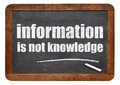 Information is not knowledge quote a from albert einstein white chalk text on a vintage slate blackboard Royalty Free Stock Image