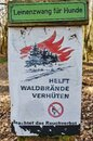 Information sign on a forest that indicates the risk of forest fires and prohibits open fires Royalty Free Stock Photo