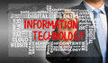 Information technology with related word cloud handwritten by bu Royalty Free Stock Photo