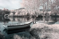 Infrared river boats landscape seeing trees and plants Stock Photo