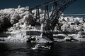Infrared river landscape of porto seeing old iron bridge and passenger boat Stock Image