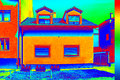 Infrared thermovision image showing lack of thermal insulation on house Stock Photos