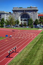 Ingram field and macdonough hall at naval academy athletic venue with outdoor race tracks in front of gymnastic loft building as Royalty Free Stock Images
