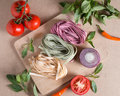 Ingredient made italian fettuccine pasta with basil, tomato, chill, onion. Royalty Free Stock Photo