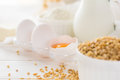 Ingredients for baking: flour, milk, wheat grain, butter and eggs Royalty Free Stock Photo