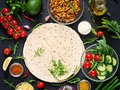 Ingredients for burritos wraps with beef and vegetables on black background. Royalty Free Stock Photo