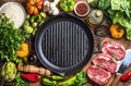 Ingredients for cooking healthy meat dinner. Raw uncooked beef steaks with vegetables, rice, herbs, spices and wine Royalty Free Stock Photo